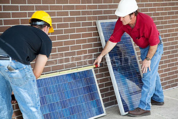 Stock photo: Electricians Measure Solar Panels