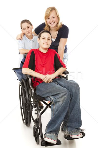 Groep kinderen een gehandicapten puber jongen Stockfoto © lisafx