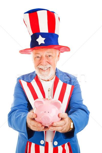 Megtakarított pénz terv amerikai nagybácsi tart persely Stock fotó © lisafx