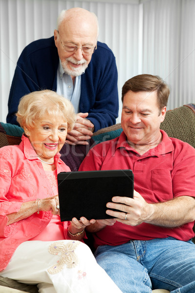 Tablet PC - Teaching Senior Parents Stock photo © lisafx