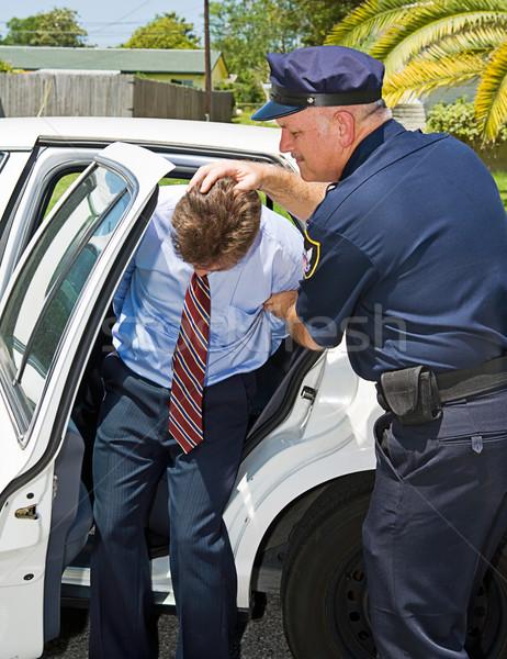 Shoved in Police Car Stock photo © lisafx
