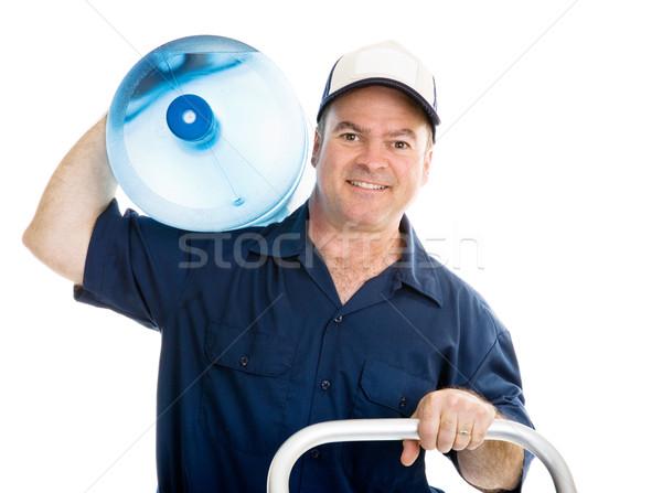 Víz házhozszállítás váll barátságos megnyerő futár Stock fotó © lisafx