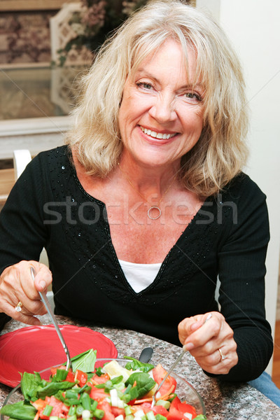 Healthy Middle-aged Woman Eating Salad Stock photo © lisafx