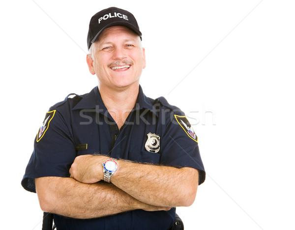полицейский смеясь счастливым изолированный белый человека Сток-фото © lisafx