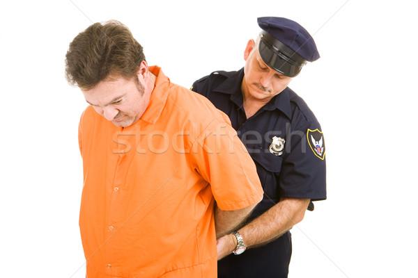 Tutuklu polis memuru turuncu atlamak takım elbise kelepçe Stok fotoğraf © lisafx