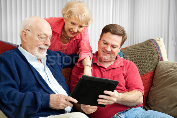 Stock photo: Family Using Tablet PC