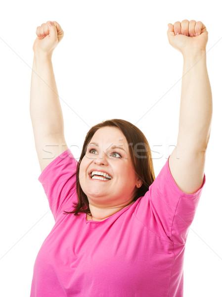 Woman Rasing Arms in Celebration Stock photo © lisafx