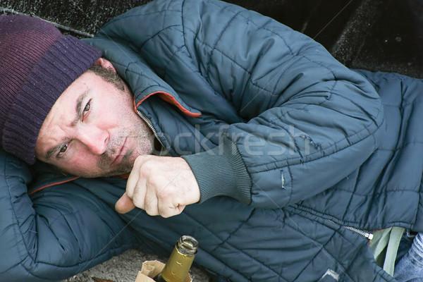 Hajléktalan férfi alszik föld hideg köhögés Stock fotó © lisafx