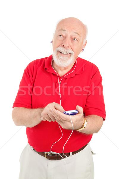 Senior man mp3-speler muziek geïsoleerd witte Stockfoto © lisafx