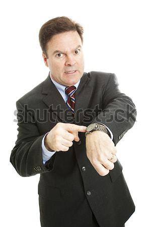 нетерпеливый бизнесмен указывая Смотреть изолированный белый Сток-фото © lisafx