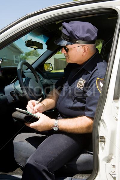 Сток-фото: полиции · Дать · полицейский · сидят · автомобилей · дороги