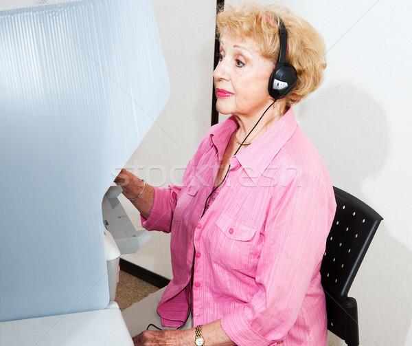 Supérieurs femme handicapées écran tactile machine Photo stock © lisafx