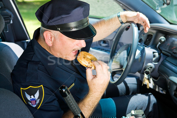 Police Officer Eating Donut Stock photo © lisafx