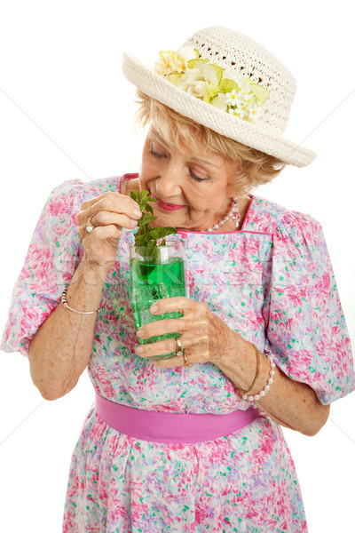 Tipsy Senior Lady Drinking Cocktail Stock photo © lisafx