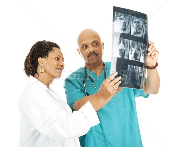 Medical Team Reviews X-Rays Stock photo © lisafx
