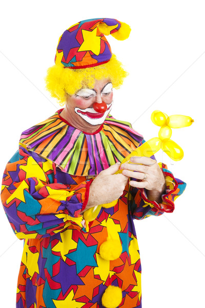 Clown Twists Balloon Into Dog Stock photo © lisafx