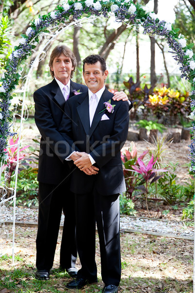 Gay Couple Under Wedding Arch Stock photo © lisafx