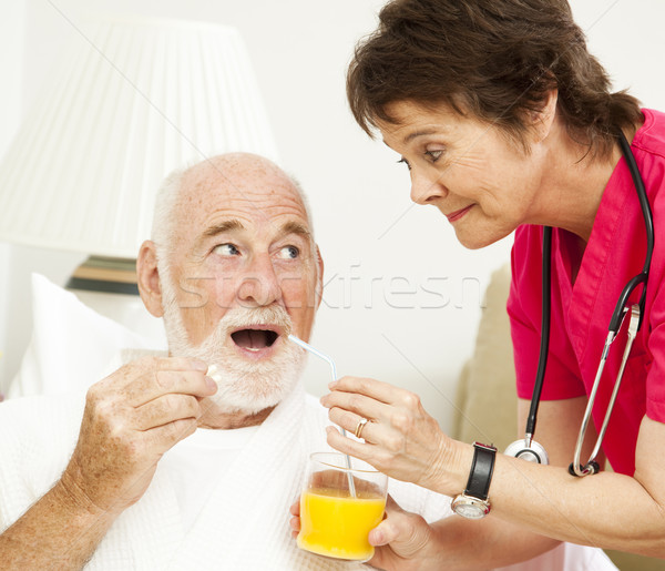 Home Health Nurse - Taking Medicine Stock photo © lisafx