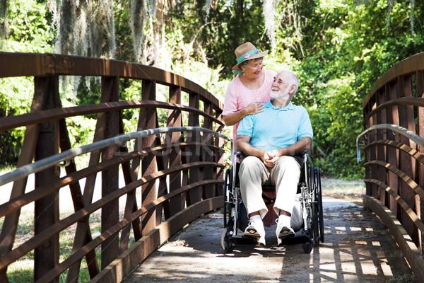Senior Caretaker on Bridge Stock photo © lisafx