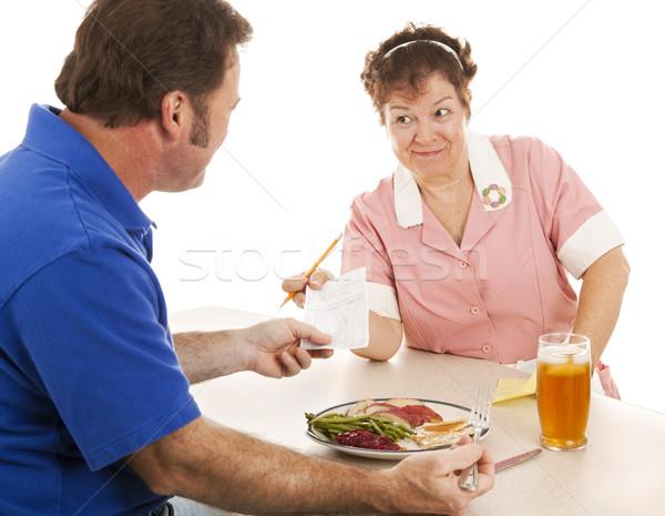 Waitress Hands Customer the Bill Stock photo © lisafx