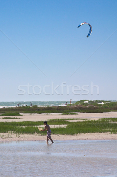 Beach Boy & Parasail Stock photo © lisafx