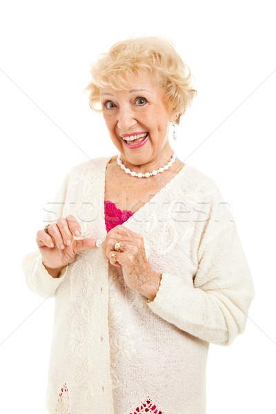 Kıdemli bayan düğmeler kazak ağrı Stok fotoğraf © lisafx
