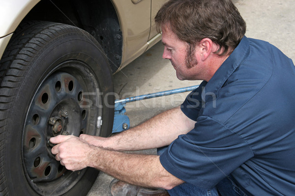 Mechanic Removing Lug Nuts Stock photo © lisafx