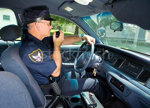 полицейский радио полицейский автомобилей говорить улице Сток-фото © lisafx
