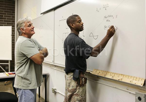 учитель смотрят студент профессиональный образование глядя Сток-фото © lisafx