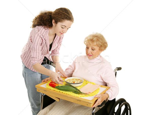 Teen volontaire supérieurs déjeuner handicapées femme Photo stock © lisafx