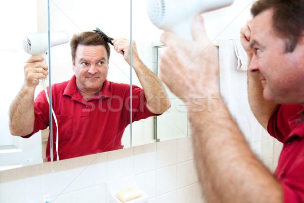 Cheveux faire sauter homme main salle de bain miroir Photo stock © lisafx