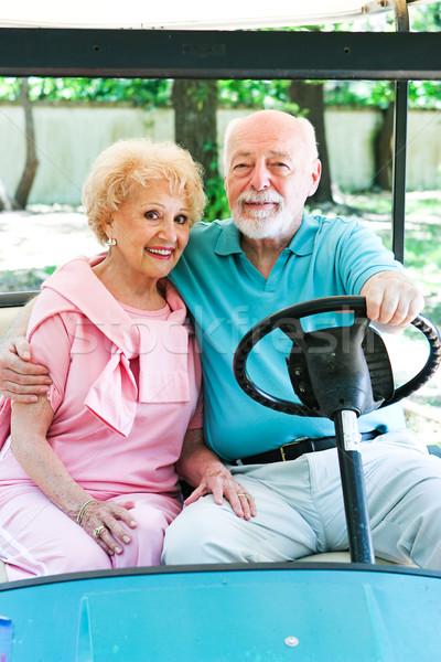 Idős pár golf kosár közlekedés felnőtt közösség Stock fotó © lisafx
