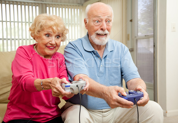 Senior Couple Play Video Games Stock photo © lisafx