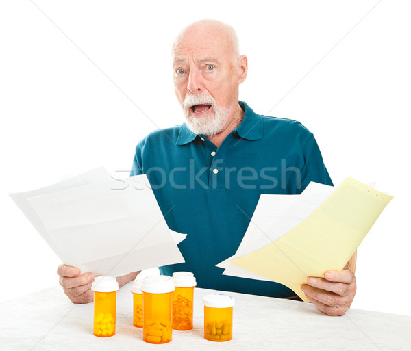 Stock photo: Senior Overwhelmed by Medical Costs