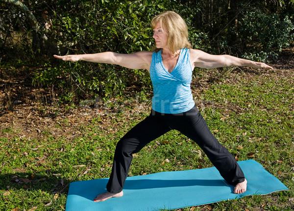 Mature Woman Yoga - Warrior Asana Stock photo © lisafx