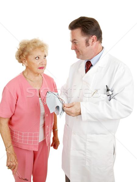 Optik optometrist kıdemli kadın konuşma yeni Stok fotoğraf © lisafx