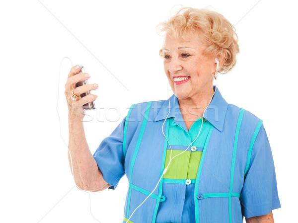 Starszy kobieta oglądania wideo piękna Zdjęcia stock © lisafx