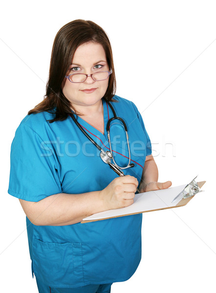 Serious Nurse Takes Notes Stock photo © lisafx
