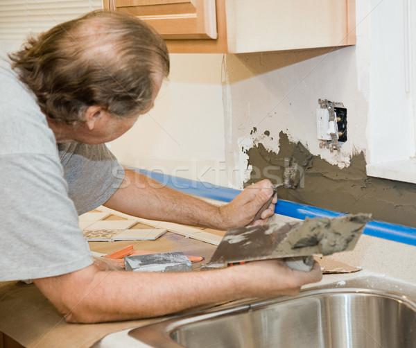 Tile Setter Applying Mortar Stock photo © lisafx