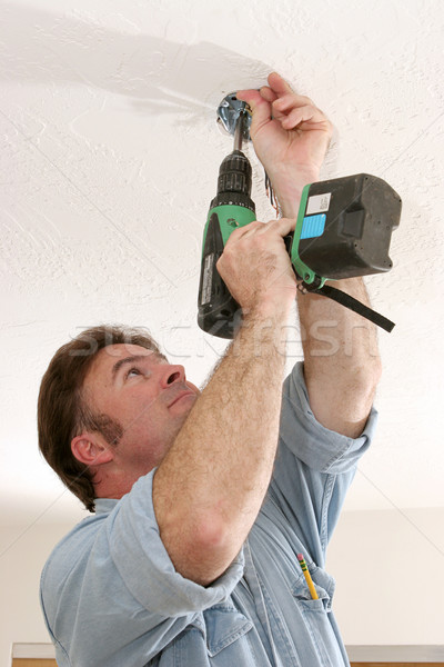 Electrician Installing Fan Box Stock photo © lisafx