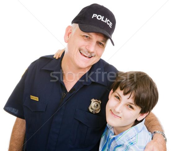 Rendőr fiú barátságos rendőrtiszt kamasz izolált Stock fotó © lisafx