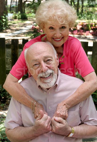 Szeretet boldog idős pár átkarol kint sok Stock fotó © lisafx