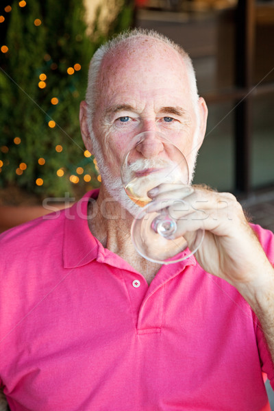 Senior Man Enjoys a Glass of Wine Stock photo © lisafx