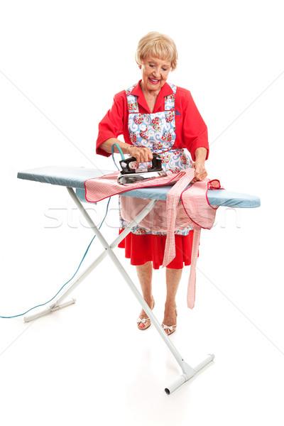 Idős hölgy vasalás egészalakos retro néz Stock fotó © lisafx