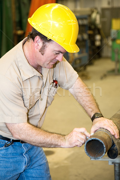 Construction Worker Marking Pipe Stock photo © lisafx