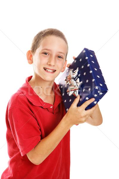 Little Boy Shaking Holiday Gift Stock photo © lisafx