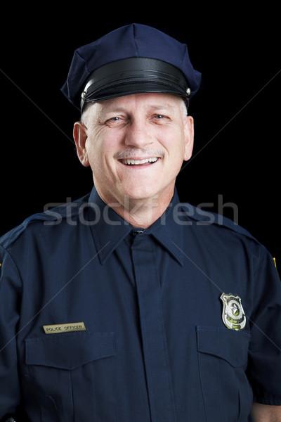Barátságos rendőr fekete portré mosolyog rendőrtiszt Stock fotó © lisafx