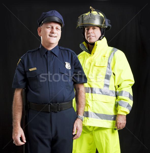 Férfiak rendőrtiszt tűzoltó együtt fekete férfi Stock fotó © lisafx