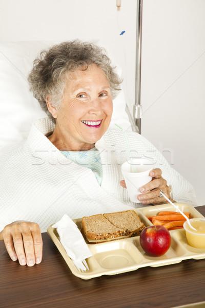 Voedzaam ziekenhuis lunch senior vrouw eten Stockfoto © lisafx