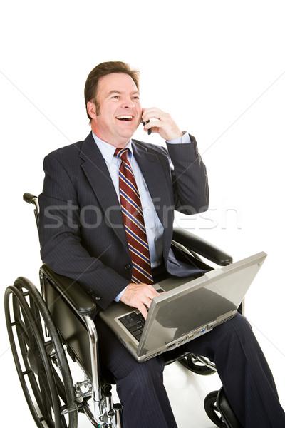 Mozgássérült üzletember kellemes chat tolószék számítógép Stock fotó © lisafx